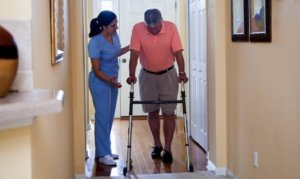 home-health-aide-home-care-for-medicare-patient-walking - Mind and mobility